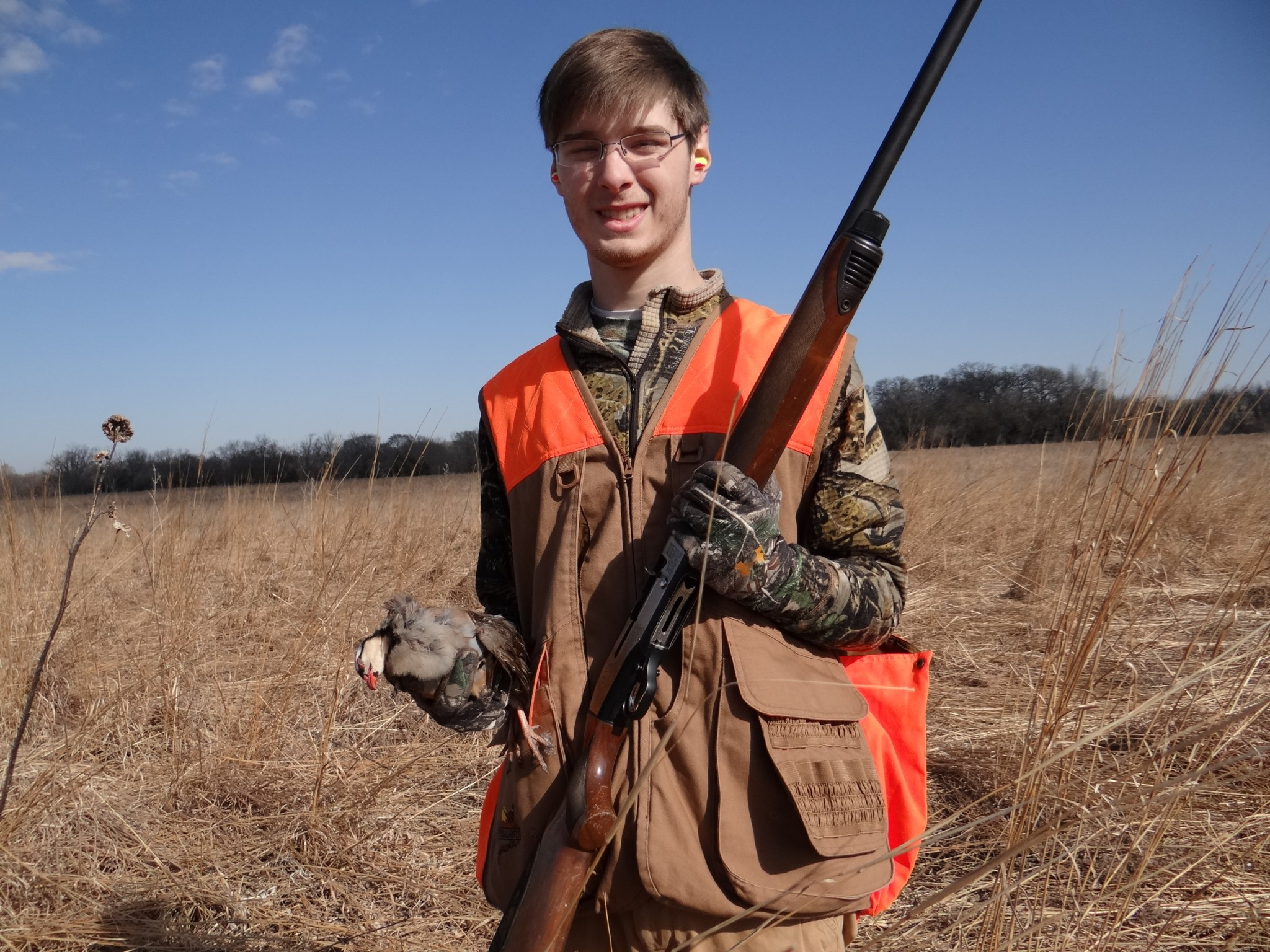 Noah displays a chuckar he had just harvested on an upland game bird hunt at the Oak Creek Sportinbg Club. Photo by Greg Wagner.