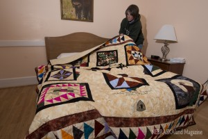 Becky Serres with quilt at Fort Robinson State Park