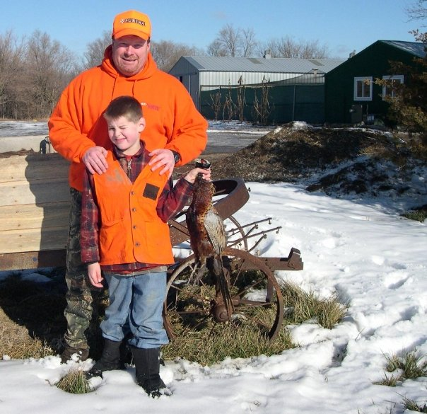 Me with young Noah Wagner and his first rooster pheasant he harvested. Photo by Andre Shousha.