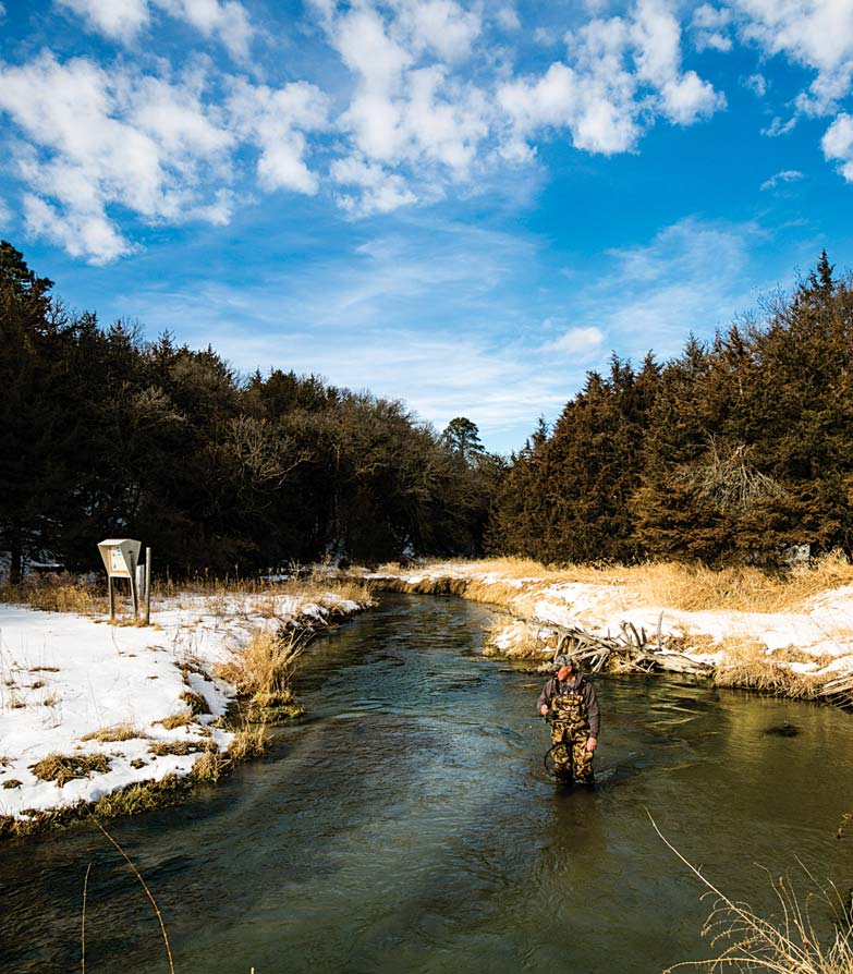 : Rick Wheatley fishes for trout in Long Pine Creek at Long Pine SRA in Brown County during the winter. Coolwater streams are also on the Aquatic Habitat Program's plan to improve fish habitat and angler access.