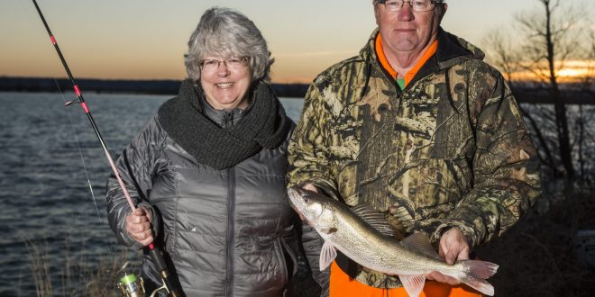 Anglers with walleye